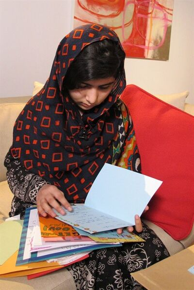 "CORRECTS CREDIT IN CAPTION - In this Jan. 22 2013 photo released Monday Feb. 4 2013, fifteen-year-old Malala Yousefzai reads get well cards. The Pakistani girl shot by the Taliban on Oct. 9 2012 has made her first video statement since she was nearly killed, released Monday, saying she is recovering. Speaking clearly but with a slight stiffness in her upper lip, Malala said that she was ""getting better, day by day."" (AP Photo/Courtesy of Malala Yousefzai)"
