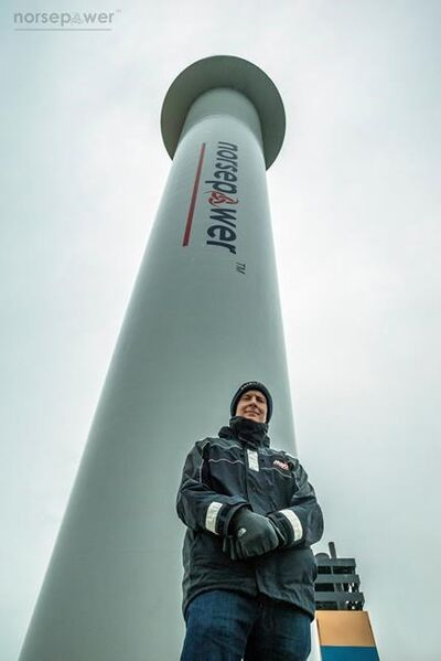 Tuomas Risk, CEO of Finnish startup company Norsepower, poses Nov. 2016, in the North Sea, in front of one of his company's rotor sails, one of the new technologies the shipping industry is looking at as it searches for new solutions to cut greenhouse gas emissions to combat climate change. The Maersk Pelican oil tanker is testing Norsepower's 30 meter (98 foot) deck-mounted spinning columns, which convert wind into thrust based on an idea first floated nearly a century ago. Transport's contribution to earth-warming emissions are the subject of investigations as negotiators gather in Katowice, Poland, for U.N. COP24 climate talks. (Norsepower via AP)