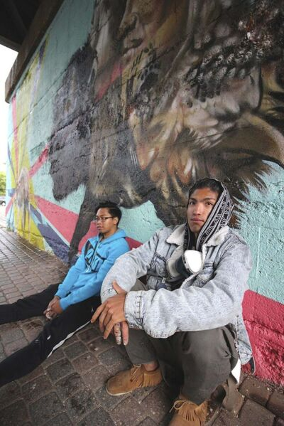 John Padua (left) and Nereo II with their first mural in the underpass at The Forks. (Jessica Botelho-Urbanski / Winnipeg Free Press)</p>