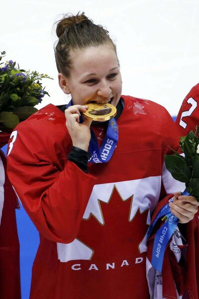 Julio Cortez / The Associated Press</p><p>Jocelyne Larocque bites her gold medal during the medal ceremony after the women&#39;s gold medal ice hockey game at the 2014 Winter Olympics in Sochi, Russia.</p>