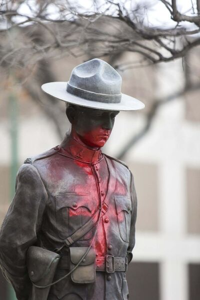 Red paint was sprayed on the statue outside RCMP D-Division headquarters on Portage Avenue. (Mikaela MacKenzie / Winnipeg Free Press)</p>