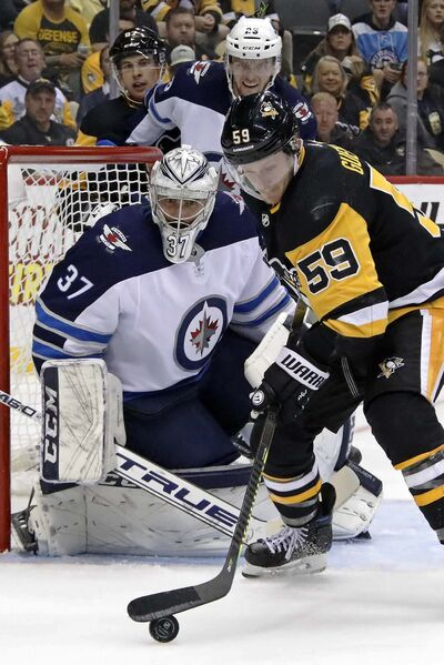 Hellebuyck was back to his old self in his next start, a 37-save effort as the Jets beat the Pittsburgh Penguins 4-1. (Gene J. Puskar / The Associated Press files)</p>