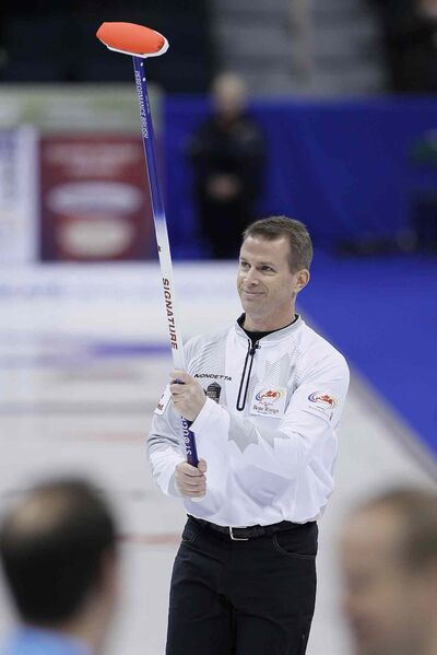 Skip Jeff Stoughton waves to the crowd after defeating Glenn Howard in draw 14 at the 2013 Roar Of The Rings championship in Winnipeg in this file photo. Stoughton's currently giving it his all at Las Vegas' Continental Cup.