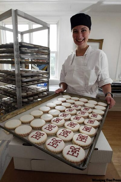 High Tea Bakery's Belinda Bigold shows off monogrammed cookies