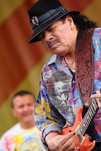 Carlos Santana performs at the 2014 New Orleans Jazz & Heritage Festival at Fair Grounds Race Course in April.