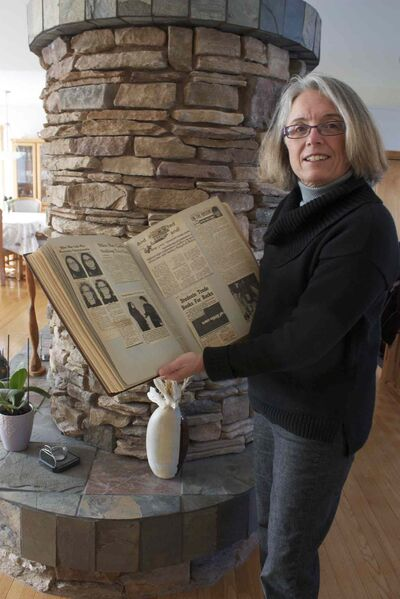 Former Miles Macdonell curler Chris Scalena is shown with a scrapbook of memorabilia of her 1972 provincial champion rink.