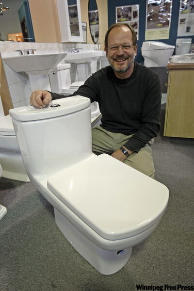 WCPotts Plumbing and Fixtures Randy Mandelik with dual flush toilet.
