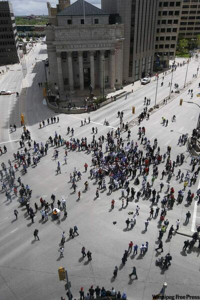 A road hockey game broke out and three replica Stanley Cups were on hand as Winnipeg NHL fans gathered at Portage and Main during True North's announcement.