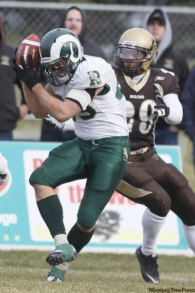 Chris Sciog (left) of the University of Regina Rams intercepts a pass intended for Nic Demski of the University of Manitoba Bisons Saturday.