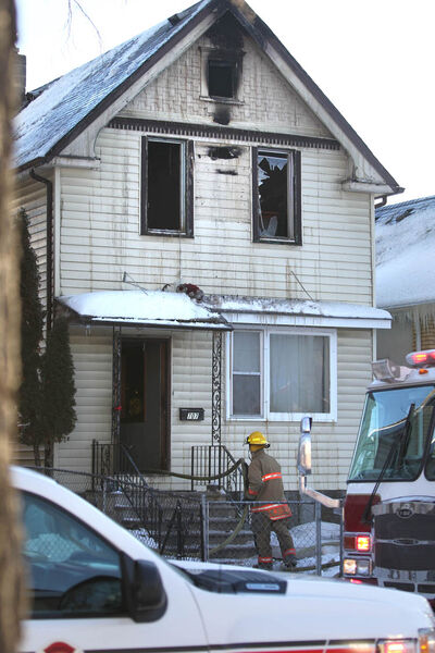 Fire crews on scene of Wellington Ave at Victor Street Saturday morning after two fires - one at the rear of the apartment block at 730 Victor St. and another at 707 Victor St.