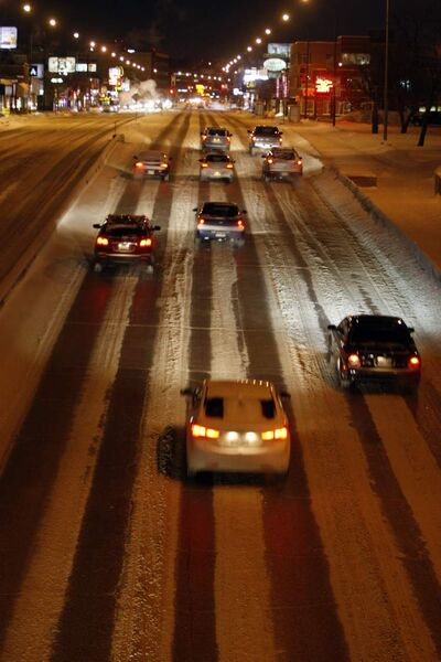 Drivers on Portage Avenue in the Polo Park area keep their distance on icy roads this morning.