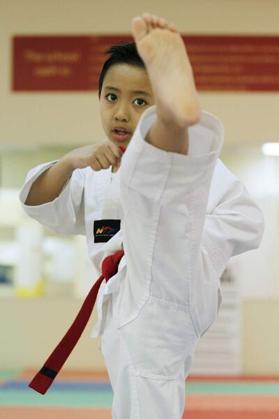 Anthony Contreras practises his taekwondo at Choi's Taekwondo school on Friday.