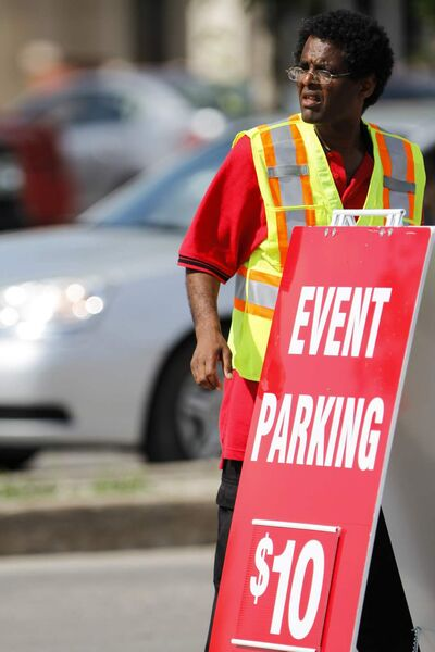 Event parking signs start to go up at the junction of Pembina Highway and Plaza Drive, directing Taylor Swift concert goers into lots on Saturday.