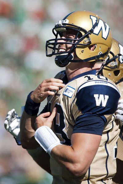 Winnipeg Blue Bombers quarterback Justin Goltz taunts the Saskatchewan Roughriders crowd while celebrating a touchdown during the first half of CFL football action in Regina.