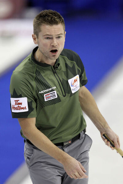 Skip Mike McEwen reacts after throwing a rock during a game against Team Jacobs Monday afternoon during the Roar of the Rings.