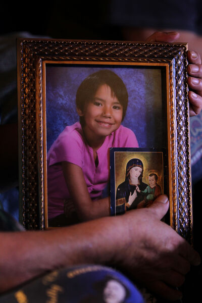 Tina Fontaine's Great Aunt, Thelma Favel holds one of her favourite pictures of Tina with a big smile (9 years old) in her home in Sagkeeng First Nation.