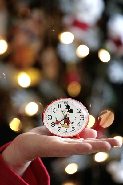 What time is it, Mickey? (Ruth Bonneville / Winnipeg Free Press)     INTERSECTION - Mickey Mouse    Photo of  Michelle Bahuaud's first Mickey Mouse themed gift, a glow-in-the-dark Bradley alarm clock, that she was given as a child which started her huge affinity for Mickey Mouse related items.      Michelle Bahuaud's (Mickey's) incredibly large collection of  Mickey Mouse  items.    For a Christmas-y Intersection piece on Michelle, who goes by Mickey, who collects Mickey Mouse paraphernalia. She has shelves, cabinets and even an entire room in her home devoted to her favourite mouse.  She has decorated her entire Christmas tree and her living room for Christmas this year, exclusively with her MM ornaments, etc.       See Dave Sanderson story.     Nov 25th   2019