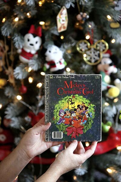 'Twas the night before Christmas and all through the house... you get the idea. (Ruth Bonneville / Winnipeg Free Press)     INTERSECTION - Mickey Mouse    Photo of Mickey's Christmas Carol book that Michelle had as a child.      Michelle Bahuaud's (Mickey's) incredibly large collection of  Mickey Mouse  items.    For a Christmas-y Intersection piece on Michelle, who goes by Mickey, who collects Mickey Mouse paraphernalia. She has shelves, cabinets and even an entire room in her home devoted to her favourite mouse.  She has decorated her entire Christmas tree and her living room for Christmas this year, exclusively with her MM ornaments, etc.       See Dave Sanderson story.     Nov 25th   2019