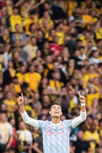 Manchester United's Cristiano Ronaldo celebrates after scoring the opening goal during of the Champions League group F soccer match between BSC Young Boys and Manchester United, at the Wankdorf stadium in Bern, Switzerland, Tuesday, Sept. 14, 2021. (Alessandro della Valle/Keystone via AP)
