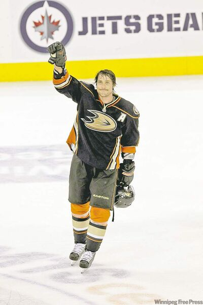Winnipeg Jets play the Anaheim Ducks at the MTS Centre Saturday night. Anaheim Ducks' Teemu Selanne (8) comes back onto the ice after the game after being selected as the first star of the game. 111217 - Saturday, December 17, 2011 -  (MIKE DEAL / WINNIPEG FREE PRESS)