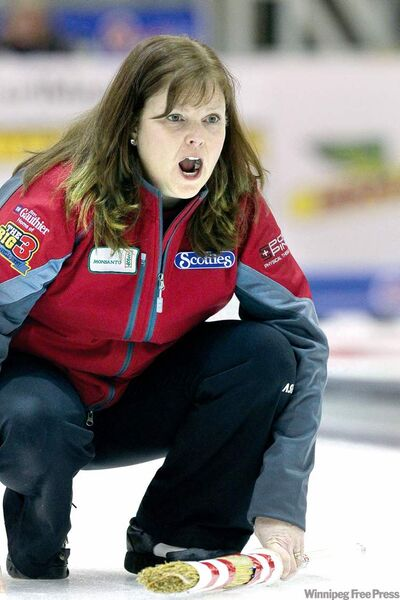 Skip Barb Spencer yells instructions to teammates during Friday night's showdown with Jennifer Jones in Portage.