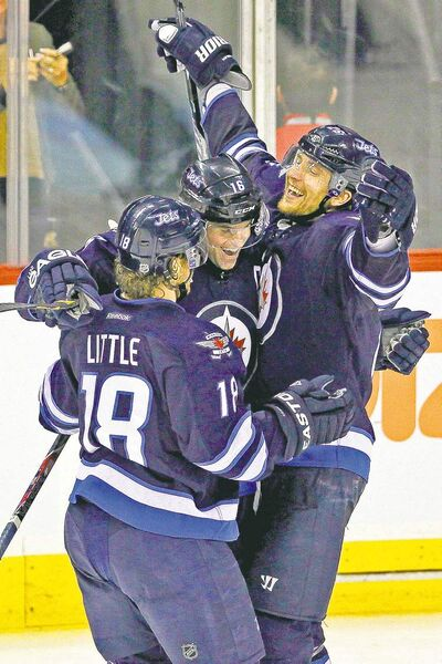 john woods / winnipeg free press Winnipeg Jets' Andrew Ladd (16), Bryan Little (18) and Blake Wheeler (26) celebrate Ladd's goal Sunday.