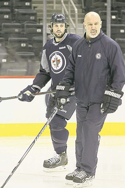 Mike Deal / Winnipeg Free Press Jets defenceman Zach Bogosian skates with assistant coach Charlie Huddy during optional skate on Tuesday.