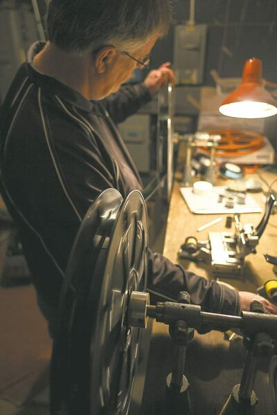 Terry Nelson splices film in the projection room at the Stardust Drive-In theatre. The drive-in opened in Morden in 1964 and has been run by the same family ever since.