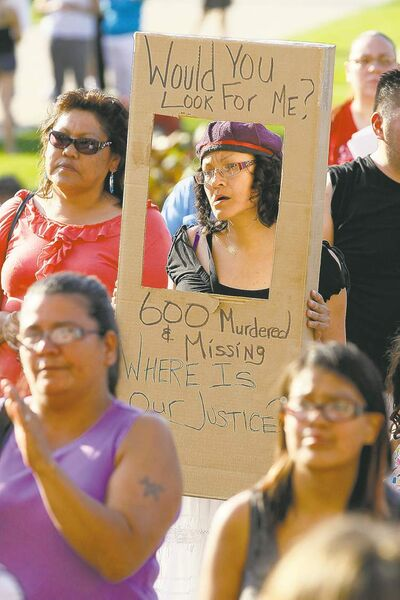 Family, friends marched downtown for victims.