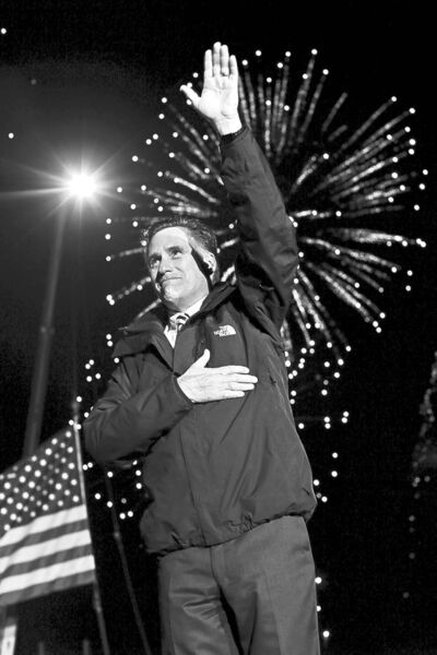 Republican presidential candidate and former Massachusetts Gov. Mitt Romney puts his hand on his heart and waves as fireworks are seen behind him at the end of a Pennsylvania campaign rally at Shady Brook Farm, in Morrisville, Pa., Sunday, Nov. 4, 2012.