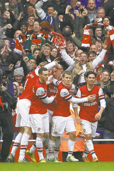 Arsenal players celebrate one of their quintet of goals against Tottenham Hotspur on Saturday.