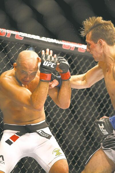 Gregory Payan / the associated press archivesRory MacDonald (right) hits B.J. Penn on the way to stopping him last Saturday.