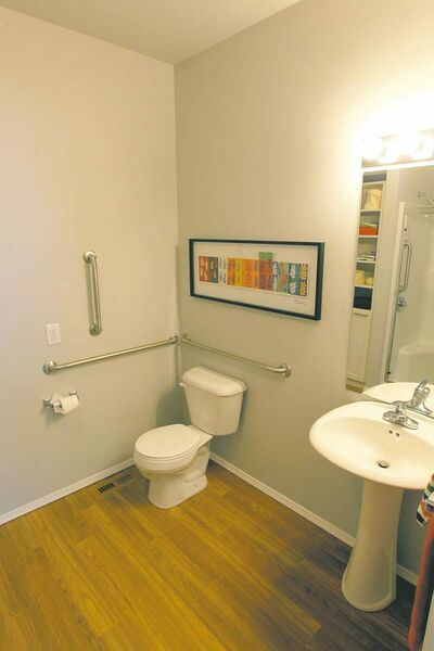 The master suite also includes a three-piece bathroom with a five-foot-wide low-stepover shower.