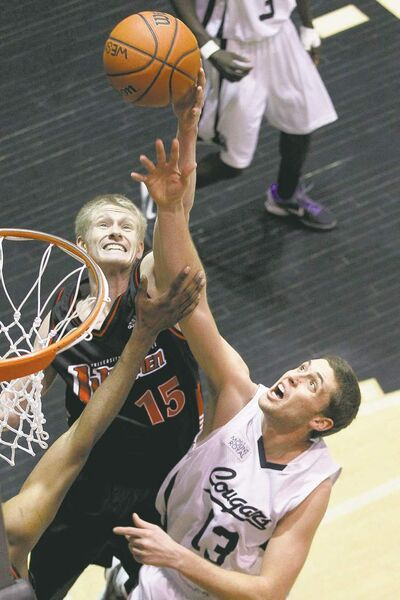 Winnipeg's Travis Krahn (15) battles Mount Royal's Kyle Wilson for a rebound Saturday night at the Duckworth Centre.