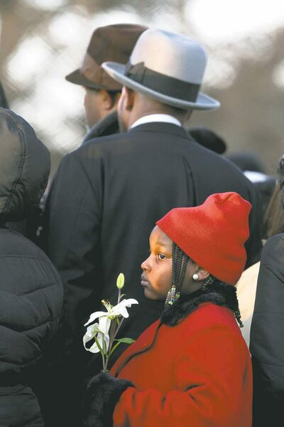 Chris Sweda / Chicago Tribune / MCT)A girl holds a flower as 15-year-old Hadiya Pendleton is laid to rest on Saturday.