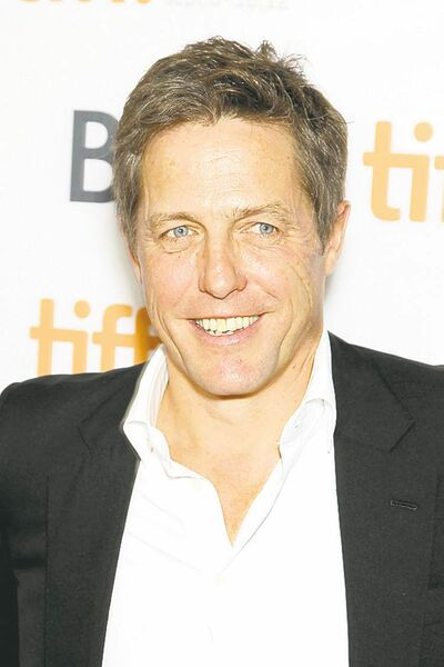 "FILE- This Sept. 8, 2012 file photo provided by Starpix shows actor Hugh Grant at the premiere of ""Cloud Atlas,"" at the Toronto International Film Festival. Lord Justice Brian Leveson will release his report, Thursday, Nov. 29 2012, on a year-long inquiry into the culture and practices of the British press and his recommendations for future regulation to prevent phone hacking, data theft, bribery and other abuses. (AP Photo/Starpix, Marion Curtis, File)"