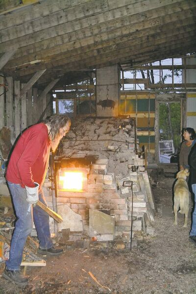 It takes 24-hours for Kirk Creed's wood-fired kiln to reach a temperature that adheres the sodium-based ash to fuse with the hand-thrown pots inside the fire brick structure.