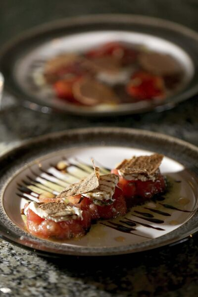TREVOR HAGAN / WINNIPEG FREE PRESS</p><p>Beef carpaccio (rear) and tomato salad at the Roost.</p>