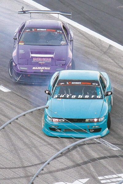 Driving sideways is raised to an art form as Formula Drift drivers put on an Ultimate Drifting exhibition.