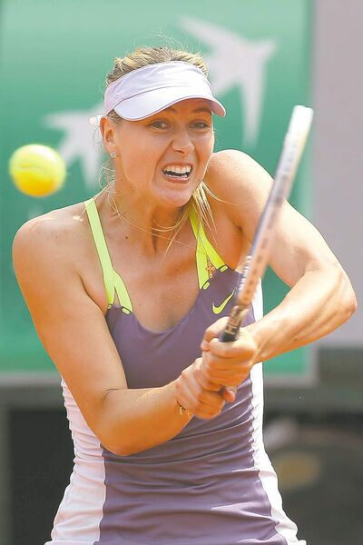 Russia�s Maria Sharapova returns against Serena Williams of the U.S. in the women�s final of the French Open tennis tournament, at Roland Garros stadium in Paris, Saturday June 8, 2013. (Michel Euler / The Associated Press archives)