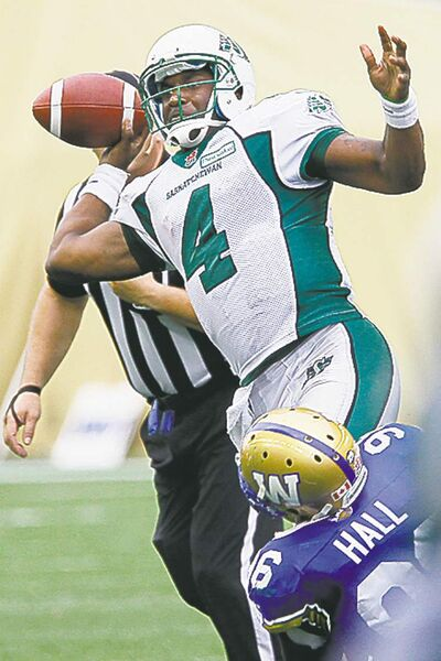 Riders QB Darian Durant gets wrapped up by Bombers' Alex Hall, one of eight sacks credited to the Blue Sunday.