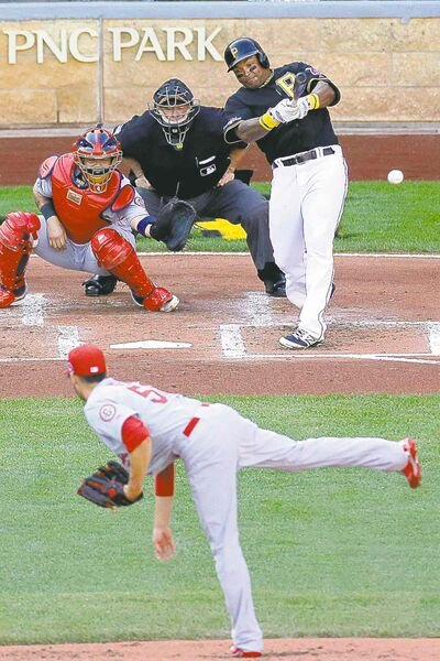 Pittsburgh Pirate Marlon Byrd lines a two-run single off Cardinals hurler Joe Kelly in the first frame of Sunday's Game 3 in Pittsburgh.
