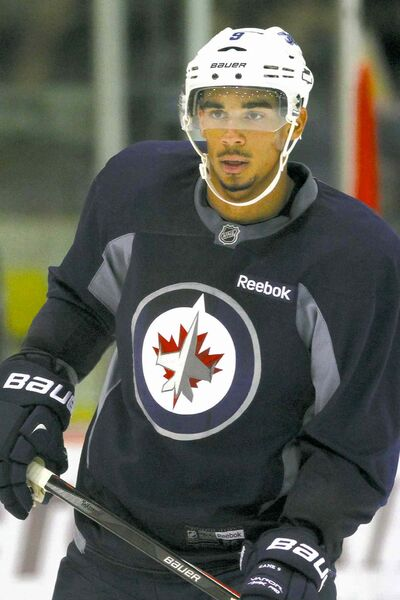 John Woods / THE CANADIAN PRESS ARCHIVESThe Jets have their fingers crossed Evander Kane can play today.