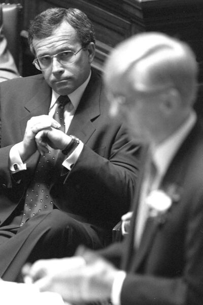 Former Manitoba premier Gary Filmon listens to his finance minister, Eric Stefanson, present  the provincial budget in the legislature in March 1998.