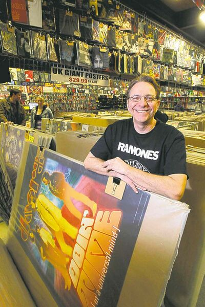 BORIS MINKEVICH / WINNIPEG FREE PRESSRoman Panchyshyn sells a wide variety of posters at his Wild Planet store.