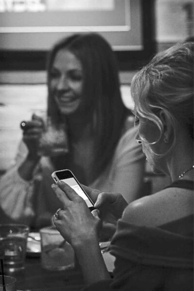 Customers text while dining at a restaurant in Manhattan Beach, Calif.