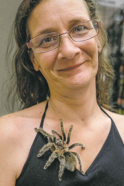 Kimberley-Anne Johnson with one of her tarantulas at the Manitoba Reptile Breeders Expo.