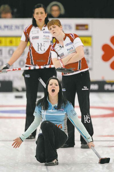 Kerri Einarson reacts to her shot as Jill Officer (left) and Dawn McEwan look on in the final of the Scotties tournament in Winkler on Sunday.