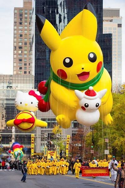 FILE - In this Nov. 24, 2016 file photo, a Pikachu balloon is seen on 59th Street during the Macy's Thanksgiving Day Parade in New York. Smokey Robinson, Jimmy Fallon, The Roots, Common and Andra Day will be among the stars celebrating at the upcoming Macy's Thanksgiving Day Parade in New York City. Macy's said Wednesday, Nov. 1, 2017, that Tony winner Leslie Odom Jr., 98 Degrees, Flo Rida, Wyclef Jean and Miss America Cara Mund also will participate in the 91st annual parade on Nov. 23. (Photo by Scott Roth/Invision/AP, file)