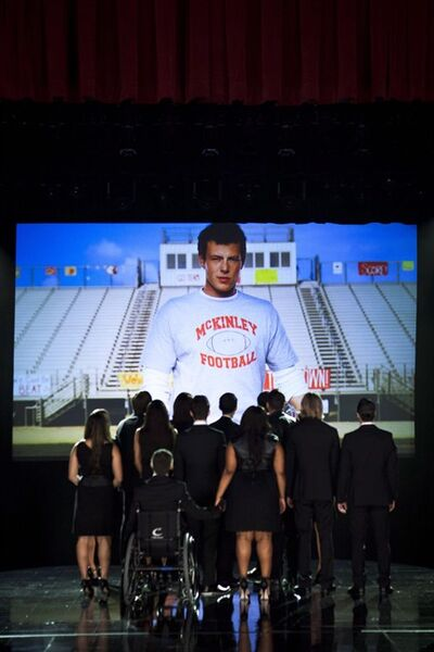 "This photo released by Fox shows the McKinley family of the past and present joining together to remember and celebrate the life of Finn Hudson in ""The Quarterback"" episode of ""Glee."" The reviews are in for the ""Glee"" tribute to Cory Monteith and his character Finn and while they're mostly positive, they are a bit mixed. THE CANADIAN PRESS/AP, Copyright Fox, Adam Rose"
